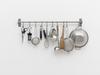 Hans-Christian Lotz. Untitled, 2017. Kitchen utensils, stainless steel rail. 42 x 80 x 15 cm