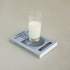 Lina Viste Grønli. Milk, Language, Metaphysics and Death, 2010. Book, glass, milk. Variable dimensions
