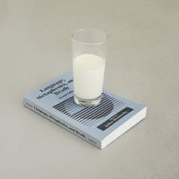 Milk, Language, Metaphysics and Death, 2010. Book, glass, milk. Variable dimensions
