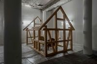 N*E*S*T, 2017. Traditional Danish timber frame structure, wire, epoxy, polyurethane, wheels, chains and bed frame with embedded mask in fibre glass and epoxy