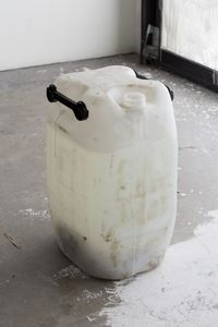 Unending Poverty, 2016. 60 l. industrial plastic drum, water, chalk, synthetic and human hair. 63 x 34 x 37 cm