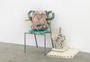 Pots, 2016. Glazed stoneware, egg tempera, concrete, foam cushion, oven plates, book and chair. 84 x 100 x 50 cm
