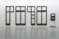 Untitled, 2018. Aluminium, acrylic glass, video, hardware, paper. 325 x 770 x 60 cm