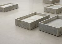 Rolf Nowotny. How Can I Sleep (detail), 2013. Beer, cow dung, moss and youghurt on concrete. 8 pieces. Each 15 x 64 x 42 cm