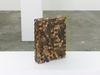 Lina Viste Grønli. Pentimento Kelloggs (Frosted Flakes), 2016. Kelloggs Frosted Flakes carton, US pennies, silicone. 34.50 x 24.50 x 7.50 cm