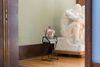 Carl Mannov. Untitled (sitter), 2017, Chalk, and egg tempera on glazed stoneware, gift shop books, and visitors stool (courtesy of The Vigeland Museum). 100 x 50 x 30 cm