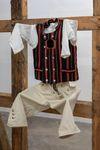 Rolf Nowotny. N*E*S*T (circumambulation), 2017-2020. Traditional Danish timber frame, Danish folk costumes, bird's nest, wood, alkyd paint, and sculpted epoxy on machine screws. 324 x 314 x 286 cm. ALKOVE, 2020. Christian Andersen, Copenhagen