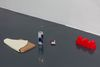 Benjamin Hirte. For Your Loved Ones, 2020. Various materials, beverage can, model building street lamp, toy castle, cigarette box, part of a chair, cardboard box. Dimensions variable. First Houses, 2020. Galerie Emanuel Layr, Vienna